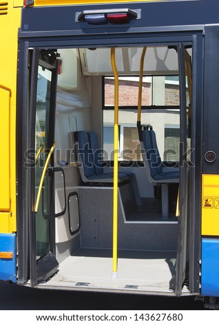 Open door of a modern public transport city bus. - stock photo