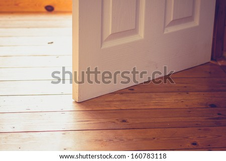 Open door on sunny day - stock photo