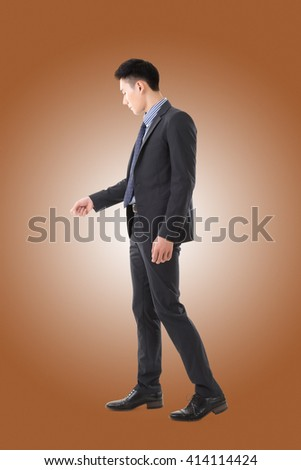open door pose, full length portrait of Asian young business man - stock photo