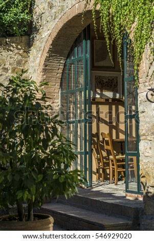 Open door to restaurant or dining room in Tuscany, Italy