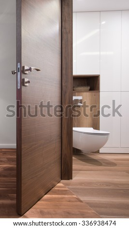 Open door to the white and modern bathroom - stock photo