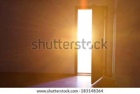 Open door with bright light outside - stock photo