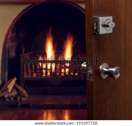 open door with fireplace in room - stock photo