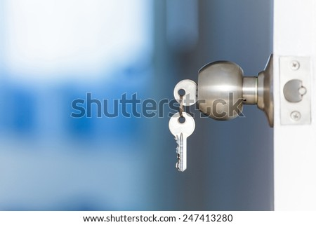 Open door with keys, key in keyhole - stock photo