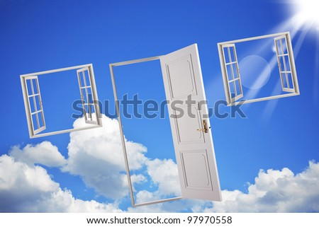 Open doors and windows in the blue sky. Abstract