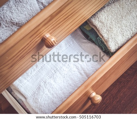 Open drawers filled with towels