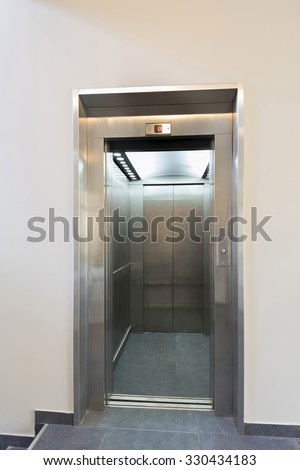 Open elevator door in hotel lobby
