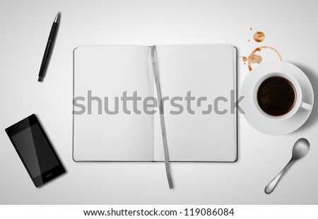 open empty book and cup of coffee - stock photo