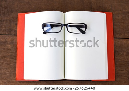 Open empty notebook with glasses. - stock photo