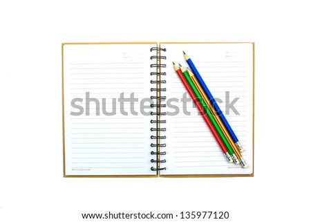 Open empty notebook with pencils and lined pages