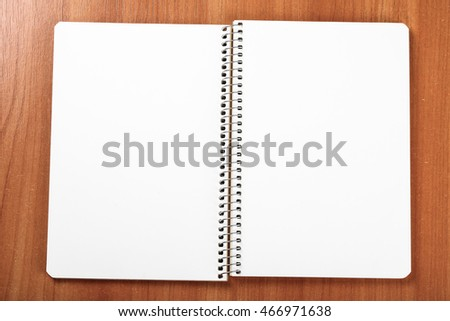 open exercise book closeup on wooden background