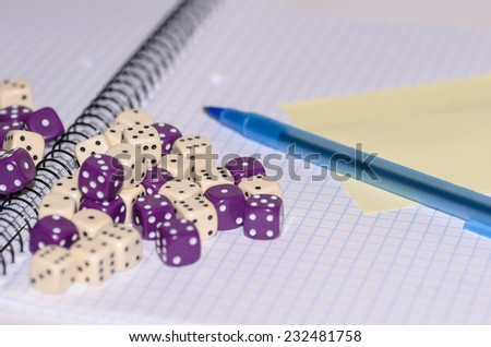 open exercise book with sticky card, pen and dices - stock photo - stock photo
