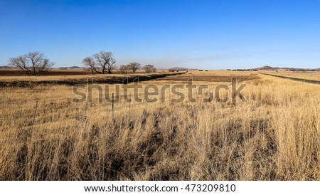 Open field with fence in the South African landscape