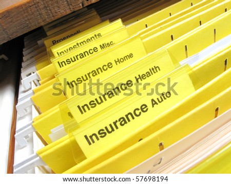 Open file cabinet showing insurance files - stock photo