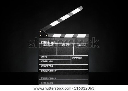 Open film slate (clapboard) against black background