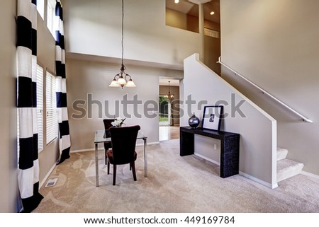 Open floor plan dining room with carpet floor and glass table
