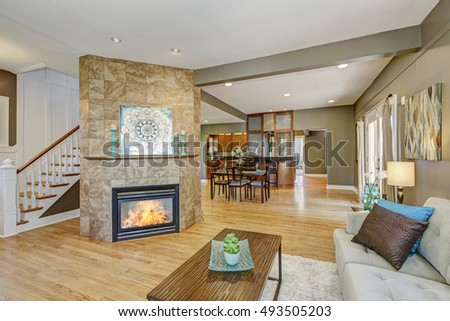 Open floor plan family room with fireplace and hardwood floor. Northwest, USA