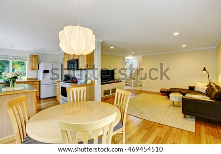 Open floor plan kitchen and living room. Also dining area at the foreground. Northwest, USA