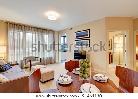 Open floor plan. Living room with dining area. View of served table