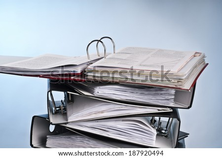 Open folder on a pile of other folders. - stock photo