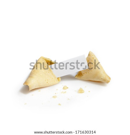 open fortune cookie with blank paper tag - stock photo
