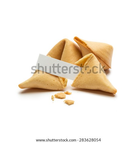 Open fortune cookie with note isolated on white background