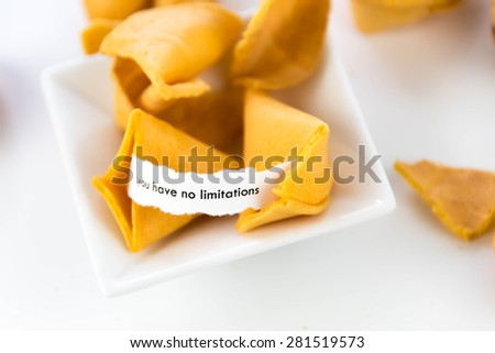 open fortune cookie with strip of white paper - YOU HAVE NO LIMITATIONS