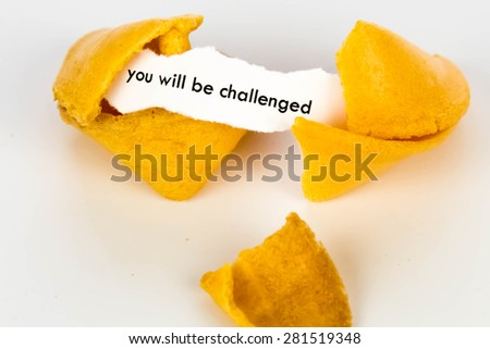 open fortune cookie with strip of white paper - YOU WILL BE CHALLENGED