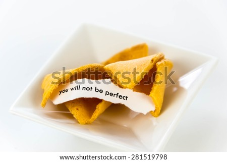 open fortune cookie with strip of white paper - YOU WILL NOT BE PERFECT