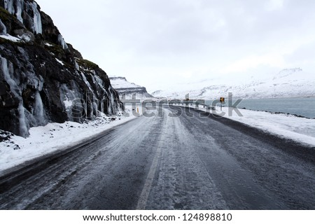 Open frozen roads in icelands east fjords in mid winter - stock photo