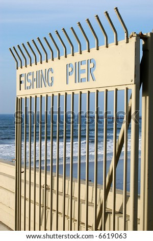 Open gate on a fishing pier; Ocean Beach; San Diego, California.