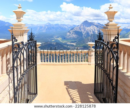 Open gate to amazing Rocky Mountains background  - stock photo