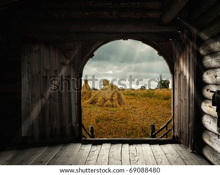 open gates of old house with view to the field