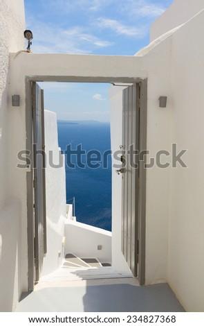 open gates to the sea and  volcano caldera, beautiful details of Santorini island, Greece - stock photo