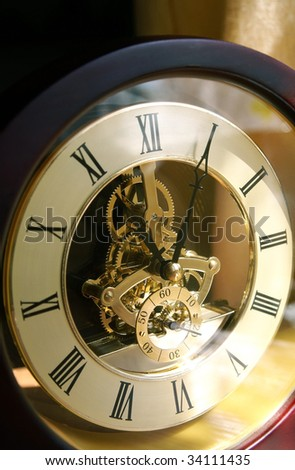 Open-gearing clock in lights and shadows, vertical - stock photo