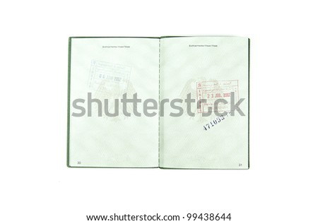 Open german passport  to two pages with some customs stamps on a white background - stock photo