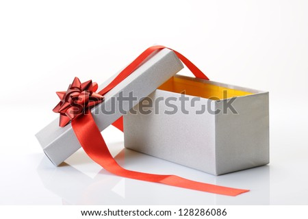 open gift box with bow and red ribbon on white background