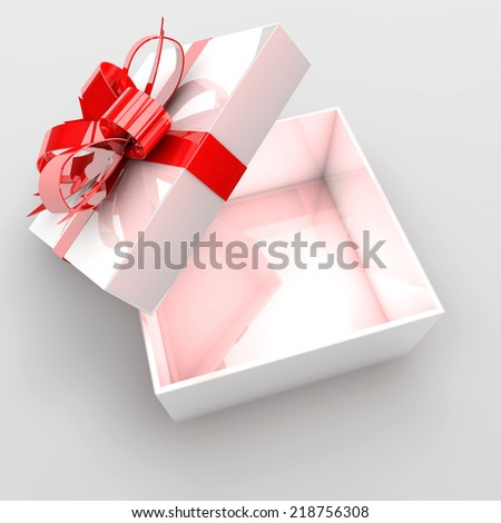 Open gift box with red bow. - stock photo