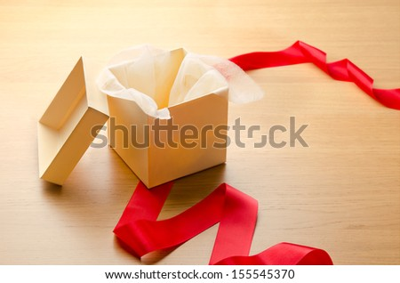 Open gift box with red ribbon - stock photo
