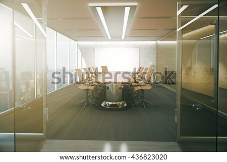 Open glass door revealing modern conference room interior with ceiling lamps, blank whiteboard on brick wall, wooden floor and panoramic window with city view. 3D Rendering - stock photo