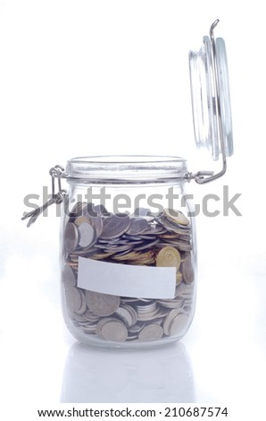 Open glass jar with coin and empty space for text - stock photo