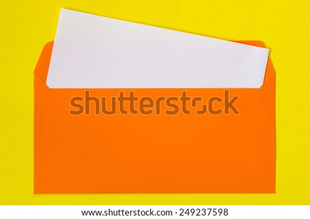 open green envelope with  blank paper on blue background - stock photo