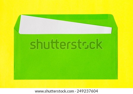 open green envelope with  blank paper on yellow background - stock photo