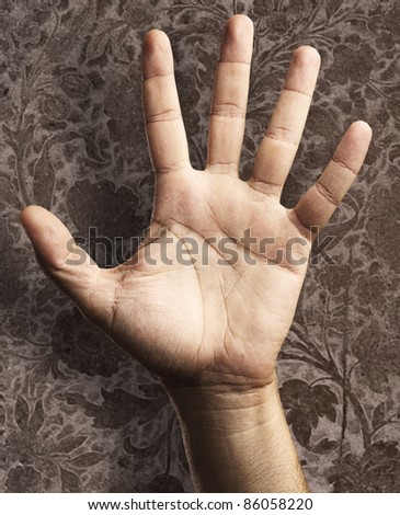 open hand against a grunge background - stock photo