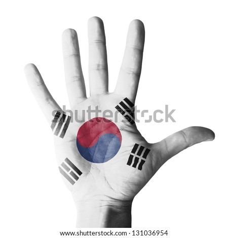 Open hand raised, multi purpose concept, South Korea flag painted - isolated on white background - stock photo