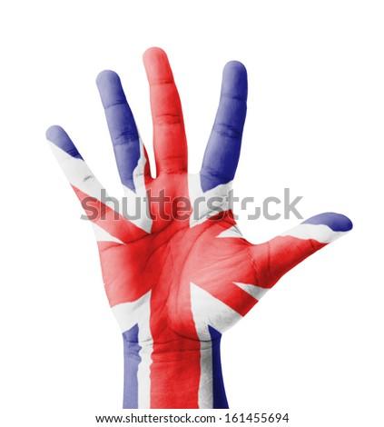 Open hand raised, multi purpose concept, UK (United Kingdom) flag painted - isolated on white background - stock photo