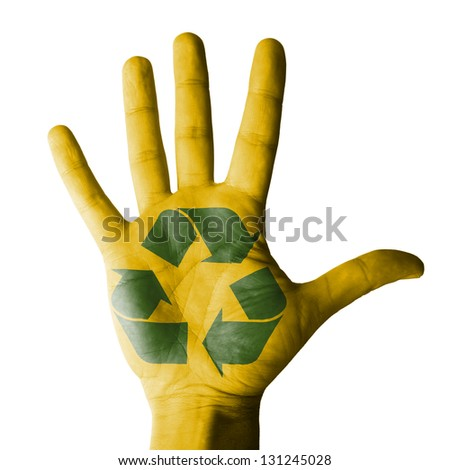 Open hand raised with recycle symbol painted - isolated on white background - stock photo