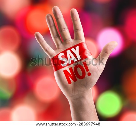 Open hand raised with the text: Say No! with bokeh background - stock photo