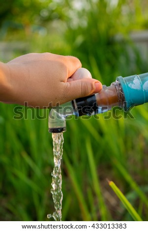 Open Hand tap water to water the plants.