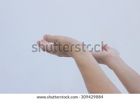 Open hand with palm up on background